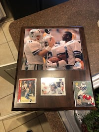 two black wooden framed photo of football players Woodbine, 21797