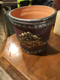 Decorative gardening pot clay maroon with silver and gold detailing St Paul