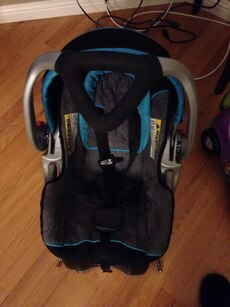 Black and blue baby car seat