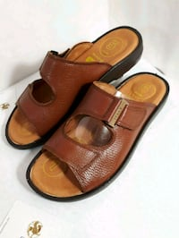 pair of brown leather slide sandals Markham, L3T 4W7