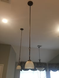 2 matching pair bronze light pendants Houston, 77040