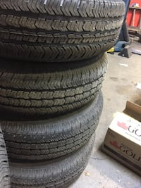 Gray 5-Jeep wheels and brand new tires