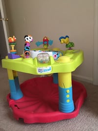 baby's green and red plastic exersaucer