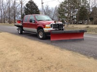 Red Ford F-250 crew-cab with western plow and spreader.  Flat bed this is a complete turn key ready to go truck.  Clean title, call or text  [PHONE NUMBER HIDDEN]