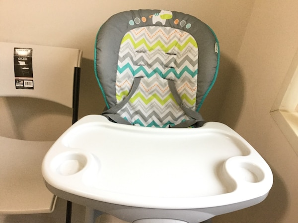 baby's white and green highchair