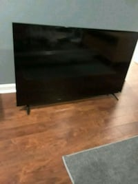 black flat screen TV with remote Olney