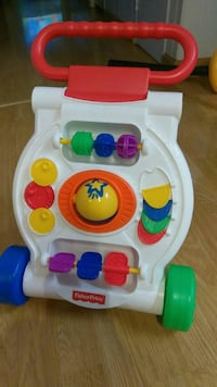white and red Fisher-Price learning walker