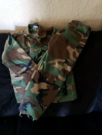 green, brown, and black camouflage cargo shorts 2296 mi