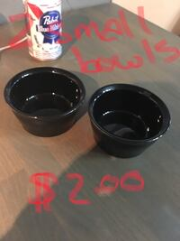 two black ceramic bowls