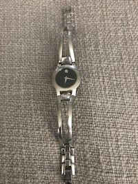 round silver analog watch with silver link bracelet Woodland Park, 07424