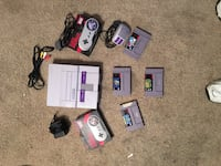 Snes bundle with Mario paint and the mouse that goes with Mario paint and 3 other games Taylorsville, 84129