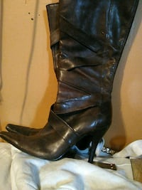 pair of black leather knee-high boots Calgary, T2B 0E5