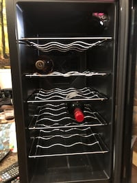 15 bottle wine cooler or shelves can be removed to put in pop has adjustable thermostat and white light in side