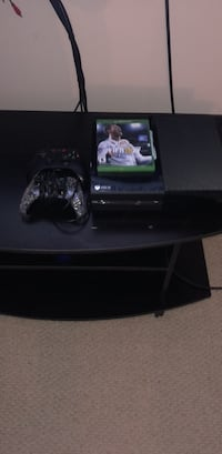 black Xbox One console with controller and game cases Newmarket, L3X 1H8