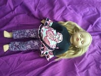 Doll; daughter is selling items to save up for another purchase.