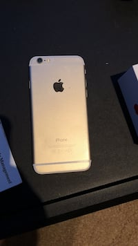 gold iPhone 6 with charger and earphones Merced, 95348