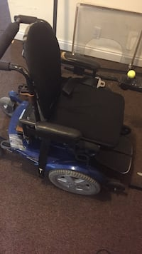 Black and blue motorized wheelchair