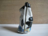black and white ceramic figurine null