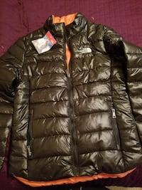 black and orange The North Face zip-up bubble jacket