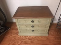 Green and brown wooden 3-drawer nightstand