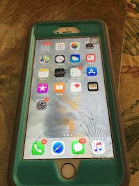 gold iPhone 6 with black case 690 mi