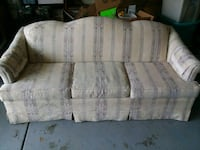white and gray floral fabric 3-seat sofa