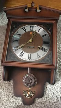 brown and gray pendulum clock St Catharines, L2R 1G5