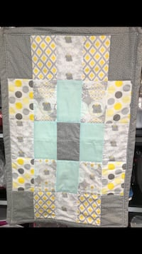 White, green, yellow, and gray textile 995 mi