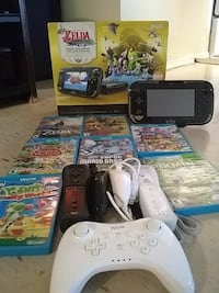 black Nintendo Wii U with game cases