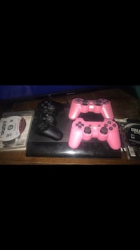 black Sony PS3 slim console with two controllers Mesa, 85213