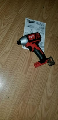 red and black Milwaukee cordless impact wrench Triangle, 22172