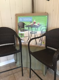 Outdoor brown wicker table and 2 chairs, new, never used $125.00, table still in box Saint Petersburg, 33709