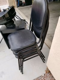 8 stackable black leather chairs