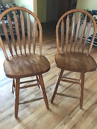 Two brown wooden barstools Sayville, 11782