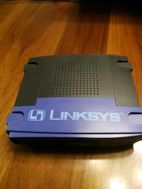 black and gray Linksys modem router Surrey, V4N 0Y9