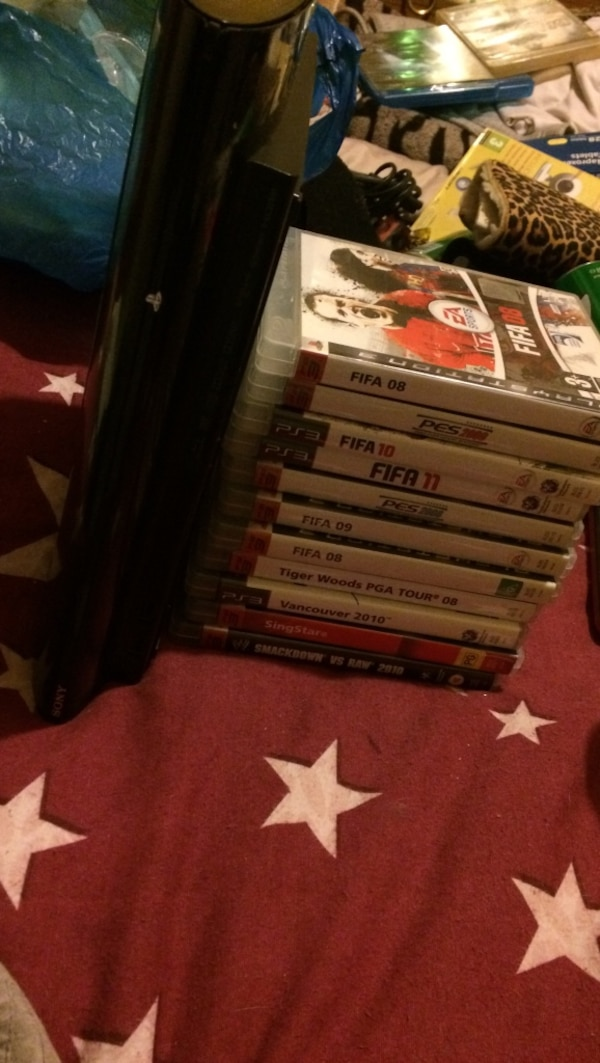 PS3 slimline and 14 games