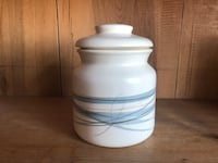 White and gray ceramic jar with lid