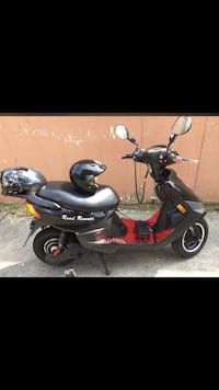 Black and red motor scooter Toronto, M6K 2Z1