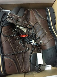 pair of black-and-brown leather logger boots
