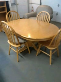 round brown wooden table with four chairs dining s North Bend, 97459