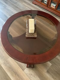Coffee table with glass inset and intricate legs