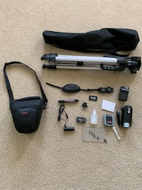 HD video camera with tripod and cleaning supplies (SD card not included)