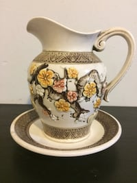 white and brown floral ceramic pitcher