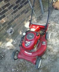 red and black push mower 887 mi