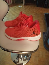 pair of red-and-white Air Jordan basketball shoes