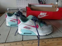 pair of white Nike Air Max shoes Holiday