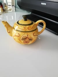 yellow and white ceramic teapot