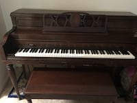 brown and white upright piano null