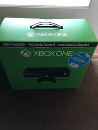 Black xbox one console, 2 controllers, 4 games