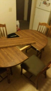 brown wooden dining table set Medicine Hat, T1B 3M1